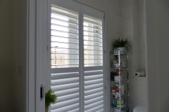 Tall Bathroom Window Fitted with Shutters with Middle Rail