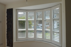 Round Bay with White Window Shutters