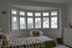 Large Round Bay Window with Shutters in Bedroom