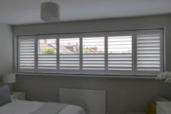 Wide Bedroom Window with Split Tilt Shutters