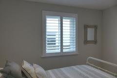 White Wooden Shutters in Modern Bedroom
