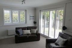 Shutters Fitted to Shallow Angled Bay Window and Patio Doors In Living Room