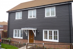 White Shutters Fitted to Large Cladded House