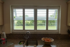 Full Height Plantation Shutters in Four Panel Window in Kitchen