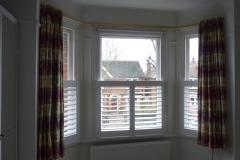 Half Height White Shutters in Angled Bay Window