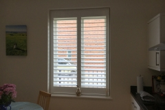 Tall White Wooden Shutters in Kitchen