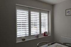 White Plantation Shutters Fitted to Three Panel Window in Kitchen Dining Room