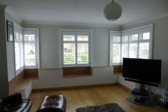 Living Room with Shutters Fitted to Corner Windows
