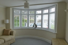 White Plantation Shutters Fitted to Large Round Bay Windows in Living Room