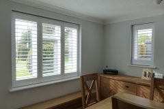 Three Panel Window and Single Window Fitted with Shutters in the Dining Room
