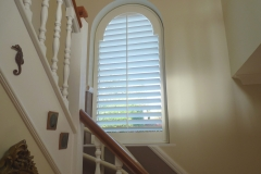 White Wooden Shutters Fitted to Arch Shape Window