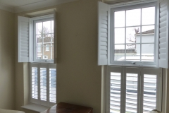 Two Sets of Top Opening Shutters with Top Shutters Open