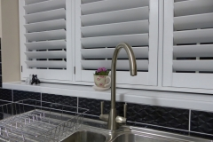Close Up of TPost Shutters Over Kitchen Sink