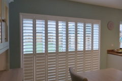 Tracked Plantation Shutter Doors with Split Tilt and Top Louvres Open