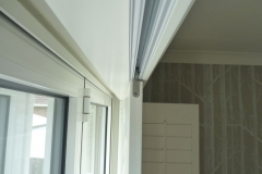 Close Up of Plantation Shutters Mounted on a Track