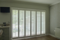 Shutters Mounted on Tracks and Fitted to Balcony Doors in Bedroom