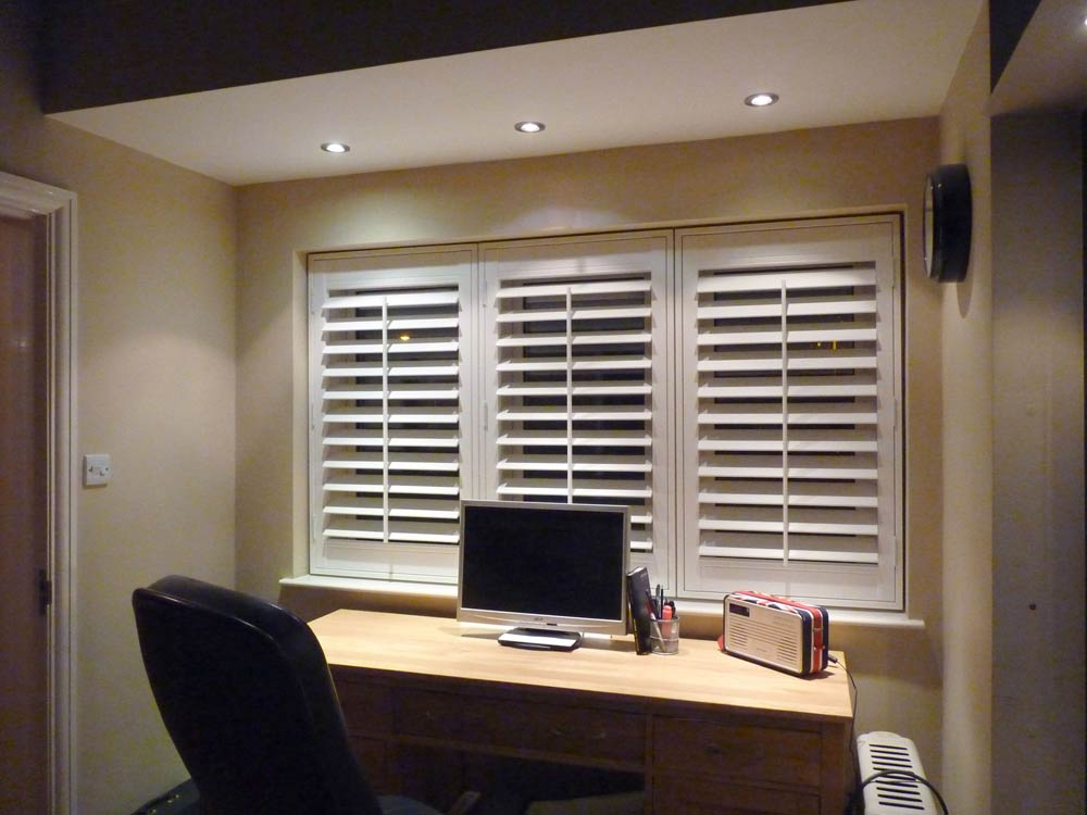 3 separate vinyl shutter frames fitted in one recess