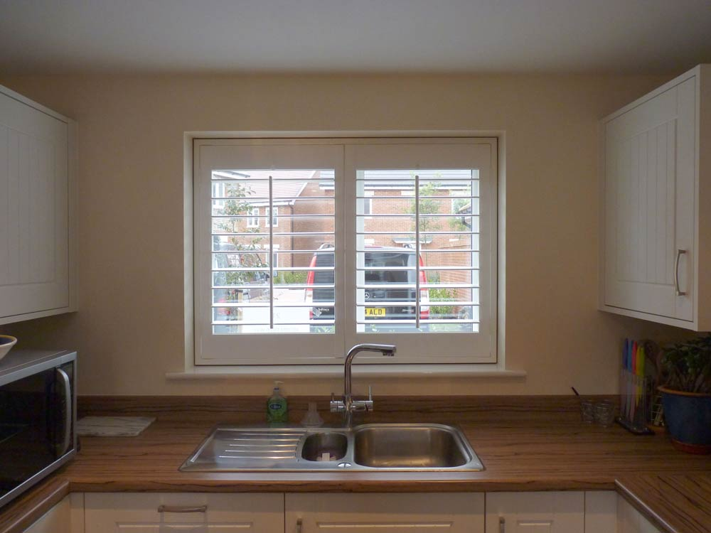 Fauxwood kitchen shutters with shadow gap