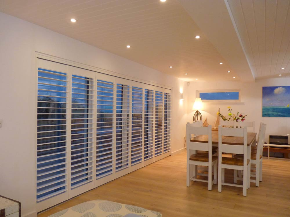 8 tracked shutters in a beach house