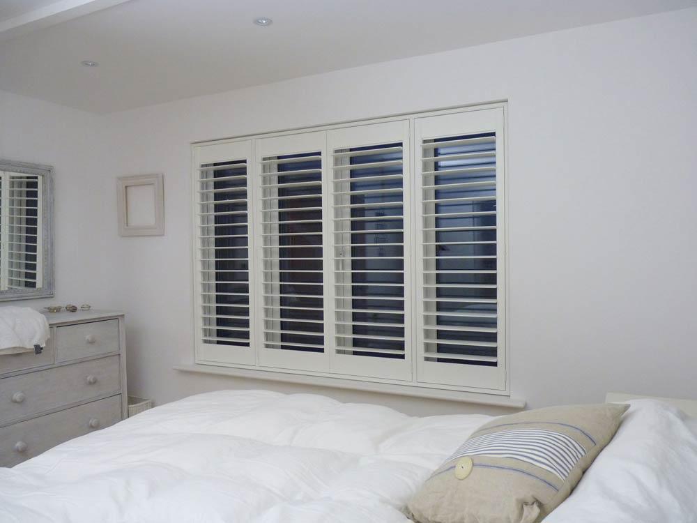 Beach house bedroom shutters