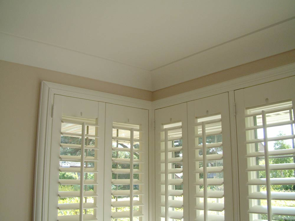 Deco frame shutters fitted around a box bay window