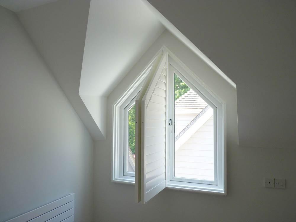 Inward open triangular shutters