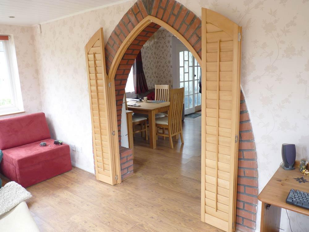 Curved oak shutters open