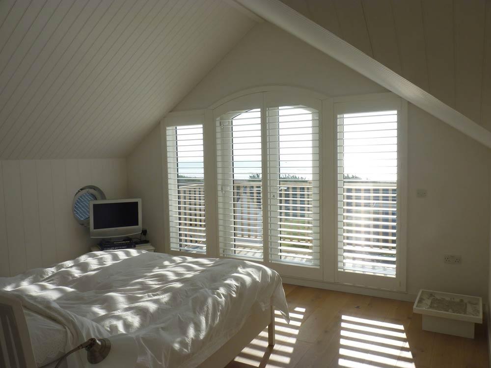 Shaped bedroom shutters