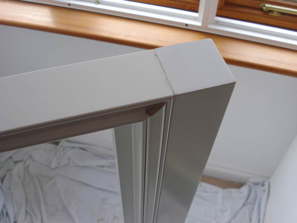A square batten fixed to the end of a shutter frame