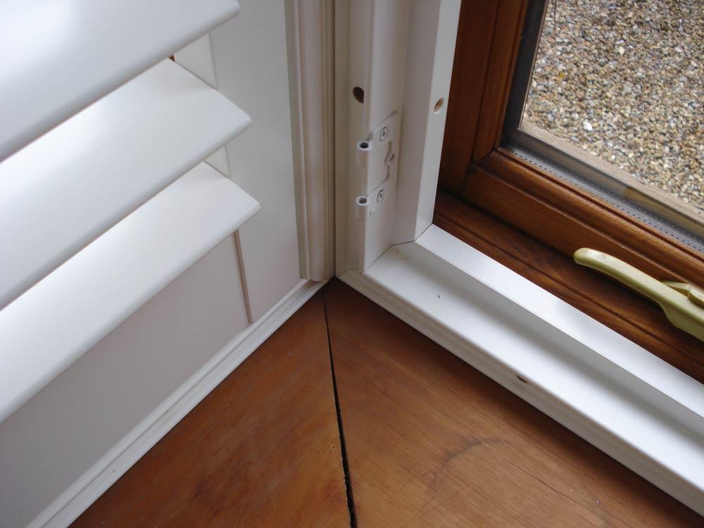 Two shutter frames meeting in the corner