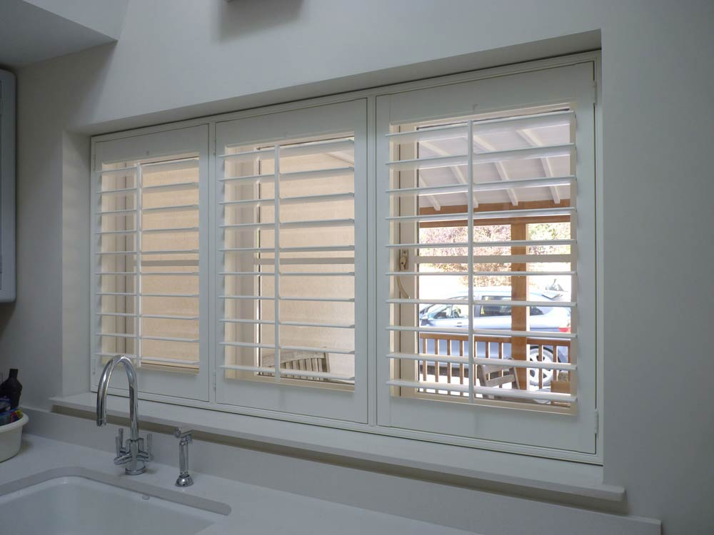 Utility room window with Tpost shutter design