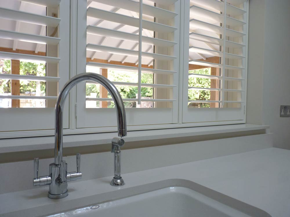 Utility shutters fitted behind a tap