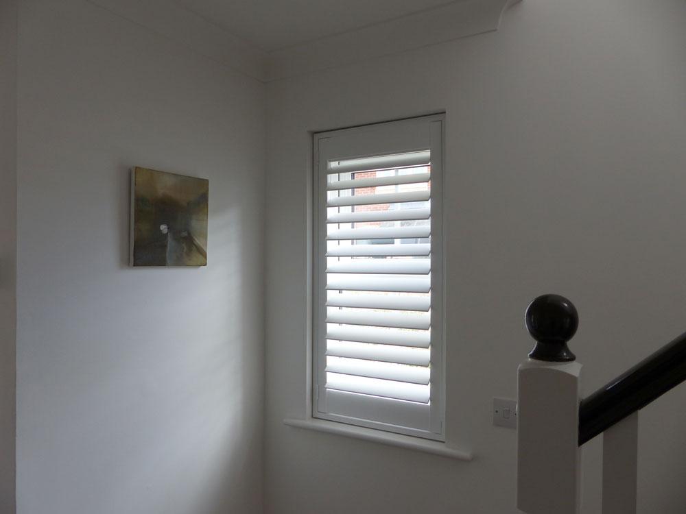 Standard Lite Shutters (Bermuda) in a hallway