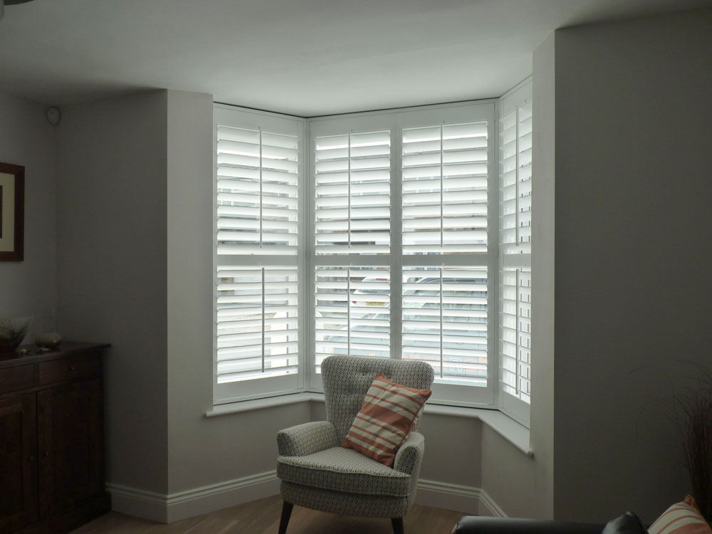 White Shutters Fitted to Small Angled Bay Window in Living Room