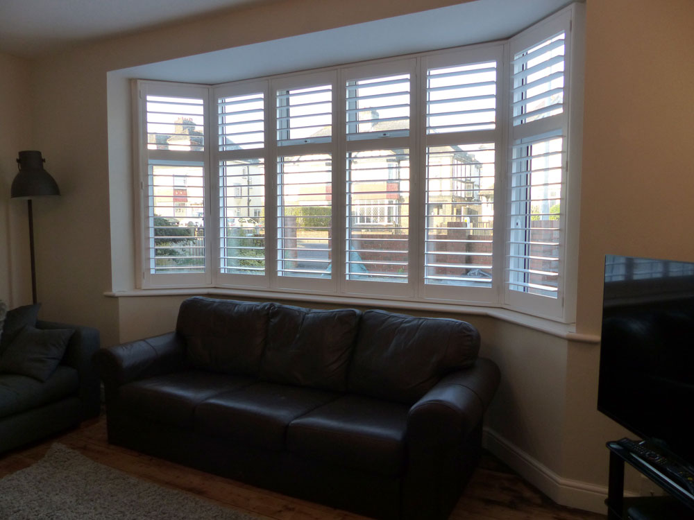Shutters on Wide Angled Bay Window in Living Room