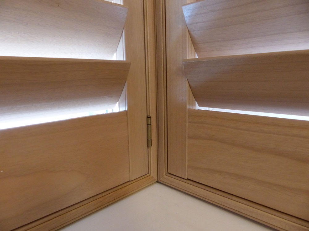 Close Up of Natural Wood Shutters in Square Bay