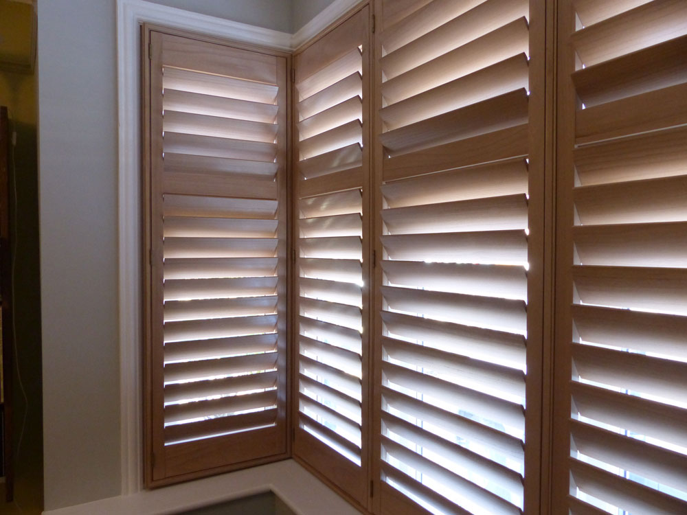 Square Bay Window with Natural Wood Shutters Fitted