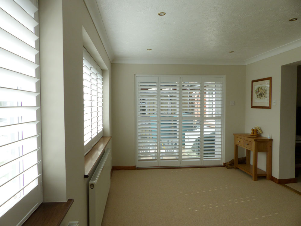 Tracked Shutters On Four Panel Patio Doors