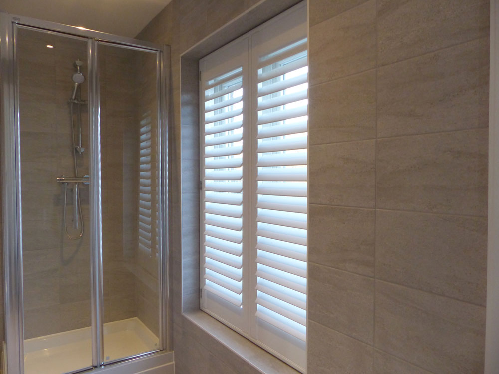 Tall Bathroom Window Fitted with Waterproof Shutters