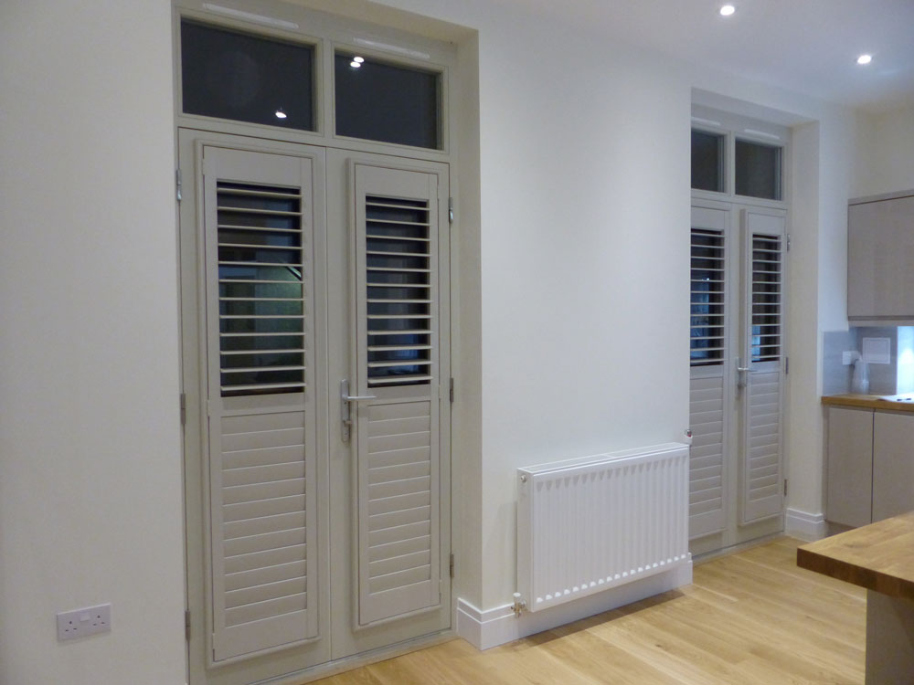 Colour Matched Grey Shutters Fitted to Kitchen Doors