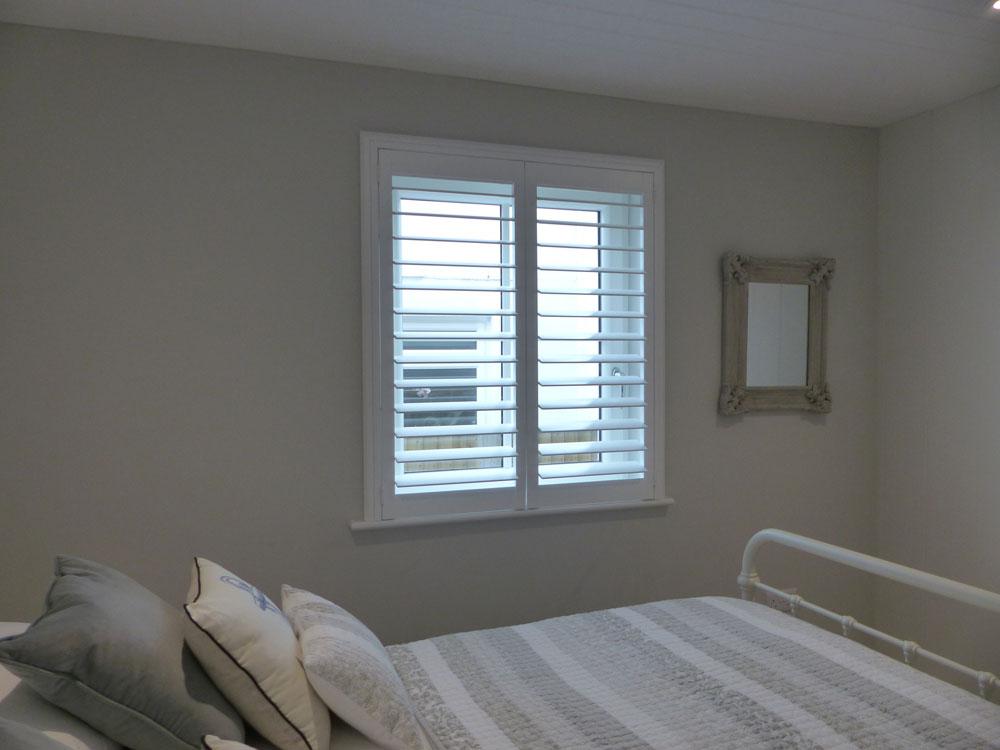 Full Height White Plantation Shutters in Bedroom
