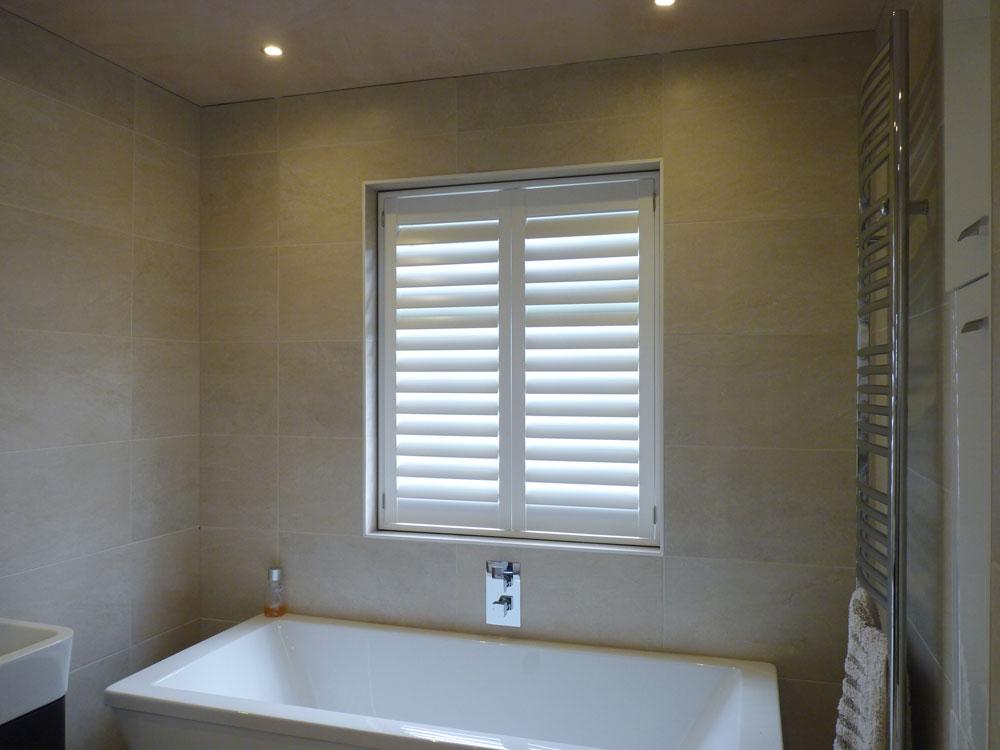 Waterproof Shutters Fitted in Window over Bath in Bathroom