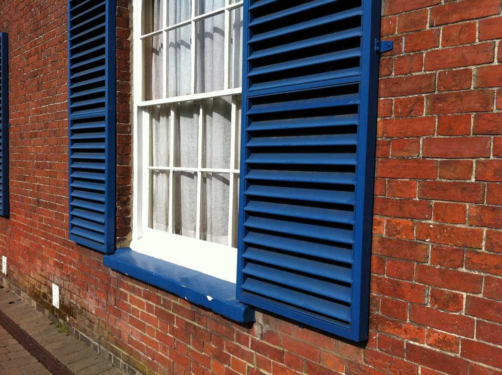 Blue Exterior wooden shutters
